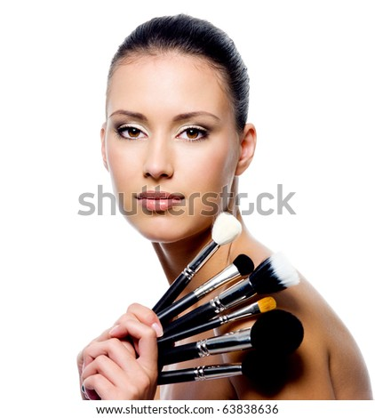Portrait of beautiful woman with makeup brushes - isolated on white - stock photo