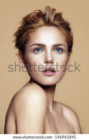 portrait of beautiful woman with nude make-up - stock photo