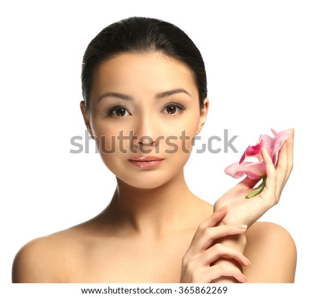 Portrait of beautiful woman with orchid flower which isolated on white background - stock photo
