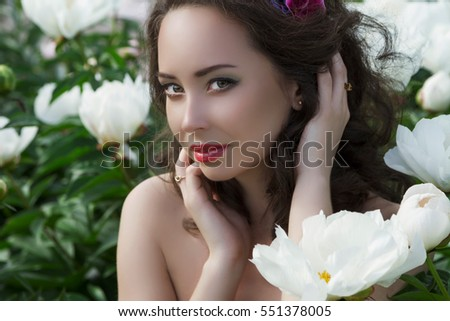 Portrait of beautiful woman with peonies