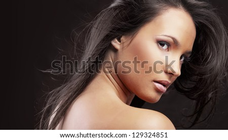 Portrait of beautiful woman with perfect make up and glossy hair - stock photo