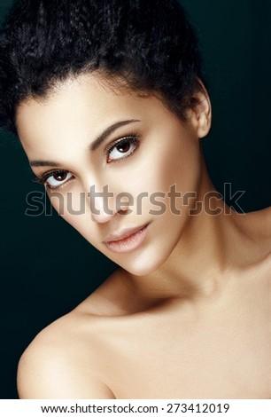 Portrait of beautiful woman with perfect shiny skin - stock photo