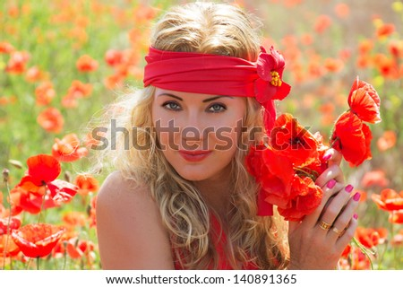Portrait of beautiful woman with poppies