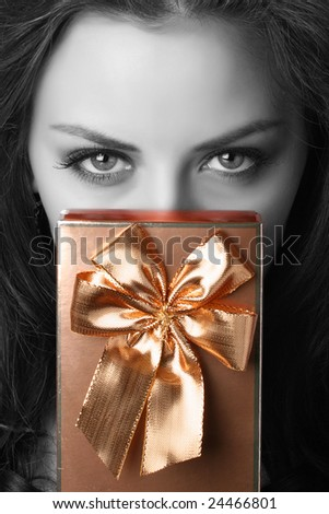 portrait of beautiful woman with present - stock photo