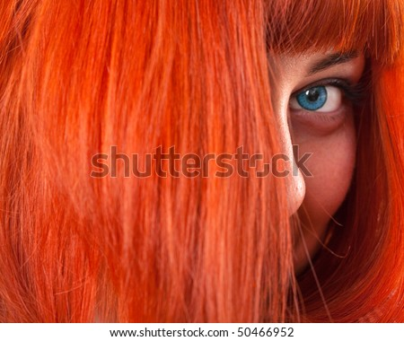 Portrait of beautiful woman with red hair - stock photo