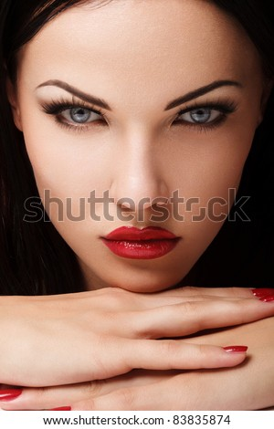 Portrait of Beautiful Woman With Red Lips. Nice Makeup Closeup. - stock photo