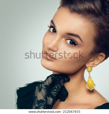 Portrait of beautiful woman with retro grab and old fashioned makeup. Vintage styled photo. - stock photo