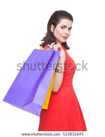 Portrait of beautiful  woman with shopping bags.