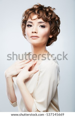 Portrait of beautiful woman with short curly hair.