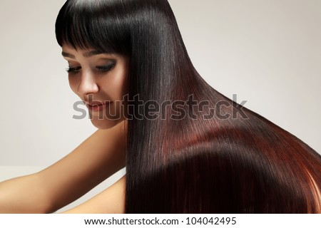 Portrait of Beautiful Woman with smooth gloss long hair. High quality image. - stock photo