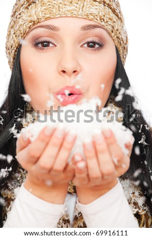 portrait of beautiful woman with snow in her palm - stock photo