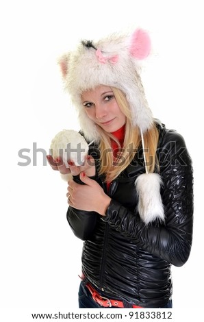 Portrait of beautiful woman with snowballs on white background