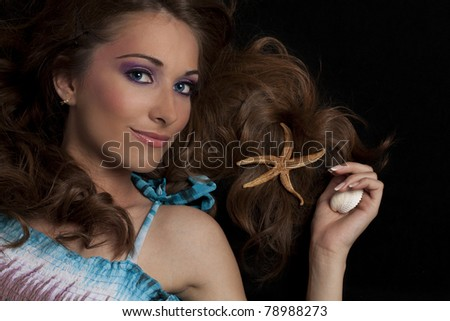 Portrait of beautiful woman with starfish