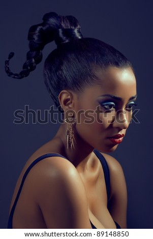 Portrait of beautiful woman with stylish creative hairstyle, on dark background