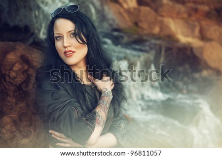 Portrait of beautiful woman with tattoo. outdoors - stock photo