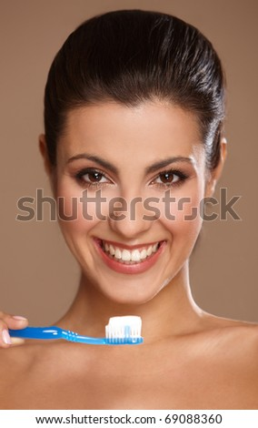 Portrait of beautiful woman with toothbrush