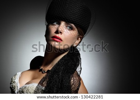 portrait of beautiful woman witn an elegant hat - stock photo
