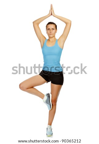 portrait of beautiful woman working out yoga exercise, isolated on white background