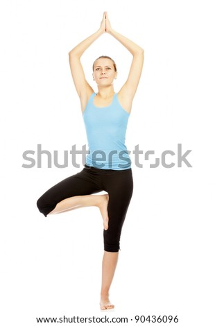 portrait of beautiful woman working out yoga exercise, isolated on white background - stock photo
