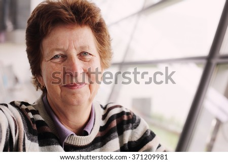 Portrait of beautiful 70 years old woman - stock photo