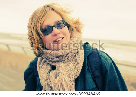 Portrait of beautiful 35 years old woman outdoors - stock photo