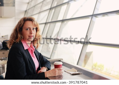 Portrait of beautiful 35 years old woman with cup of coffee - stock photo