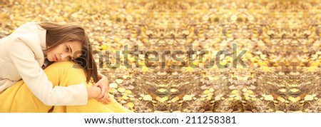 Portrait of Beautiful young adult latin hispanic woman sits on land dry leaves  in an autumn park background