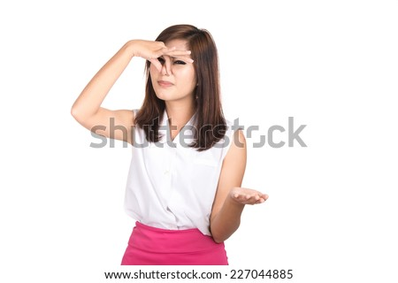 Portrait of beautiful young asian businesswoman,Woman holding her nose because of a bad smell,Negative human emotions,facial expressions,feeling ,signs,symbol,shot isolated on white background. - stock photo