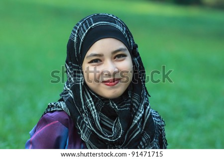 portrait of beautiful young asian muslim woman - stock photo
