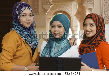 Portrait of beautiful young Asian student study together - stock photo