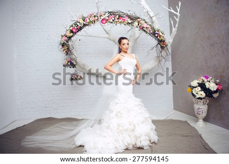 Portrait of Beautiful Young Attractive Bride with Flowers. Wedding Dress. Wedding decorations Young attractive bride with flowers - stock photo