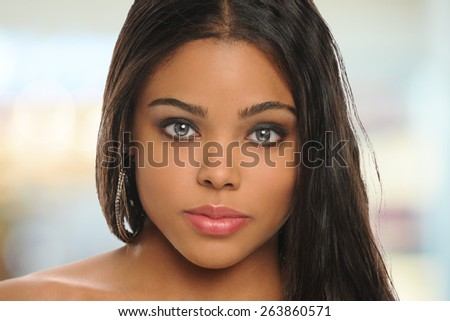 Portrait of beautiful young black woman with background out of focus - stock photo