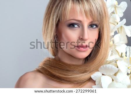 Portrait of beautiful young blond woman with clean face and long hair. Beauty female face. - stock photo