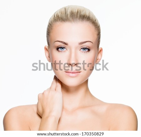 Portrait of beautiful young blond woman with clean face - isolated on white