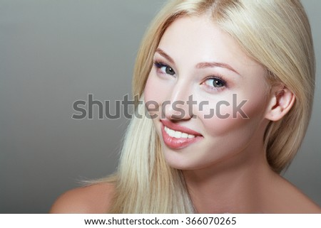 Portrait of beautiful young blond woman with clean face. Unusuall beauty