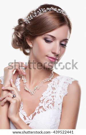Portrait of beautiful young blonde woman bride in white Wedding Dress on light gray background