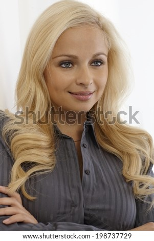 Portrait of beautiful young blonde woman looking away.