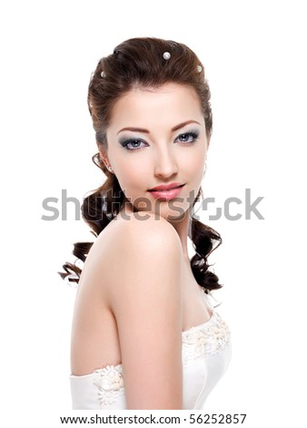 Portrait of beautiful young bride - isolated on white background - stock photo