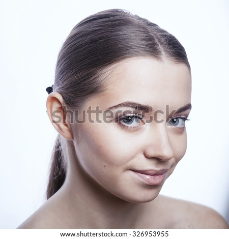 Portrait of beautiful young brunette woman with clean face on white background - stock photo