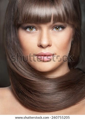 Portrait of beautiful young brunette woman with long hair