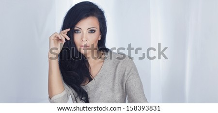 Portrait of beautiful young brunette woman with perfect makeup. - stock photo