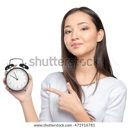 Portrait of beautiful young business woman holding in hands clock
