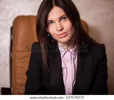 Portrait of beautiful young business woman in office.