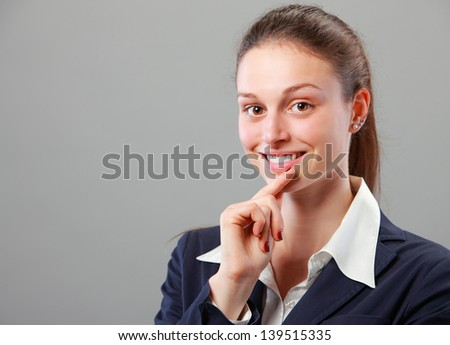 Portrait of beautiful young business woman smiling - stock photo