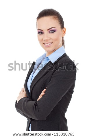 Portrait of beautiful young business woman smiling at the camera, standing with arms crossed over white background - stock photo