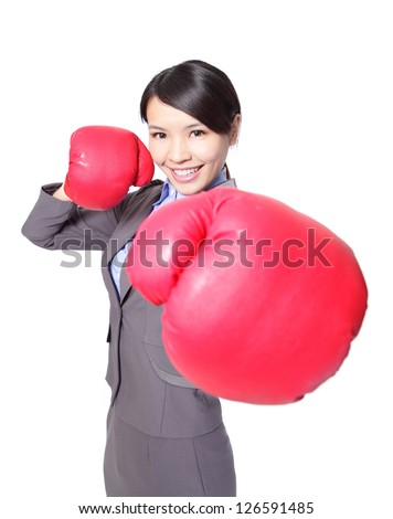 Portrait of beautiful young business woman wearing boxing gloves punching isolated on white background, asian model - stock photo
