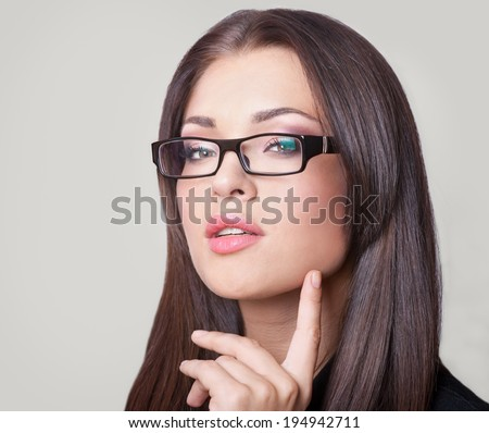 Portrait of beautiful young businesswoman in glasses