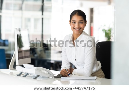 Portrait beautiful young businesswoman sitting her stock photo portrait of beautiful young businesswoman sitting at her desk in front of computer and taking notes sciox Images