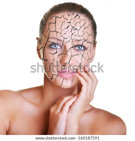 Portrait of beautiful young caucasian brunette with cracked skin - stock photo