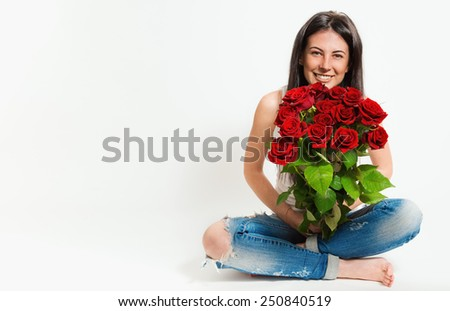 Portrait of beautiful young cheerful woman with a bouquet of flowers - stock photo